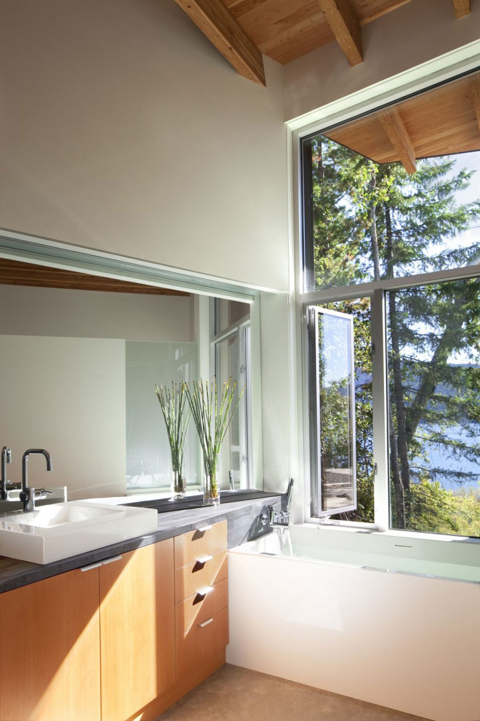 Bathroom with Aluminum Windows Overlooking the Lake Shuswap Cabin by Splyce Design