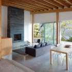 Living Room with Fireplace Shuswap Cabin by Splyce Design