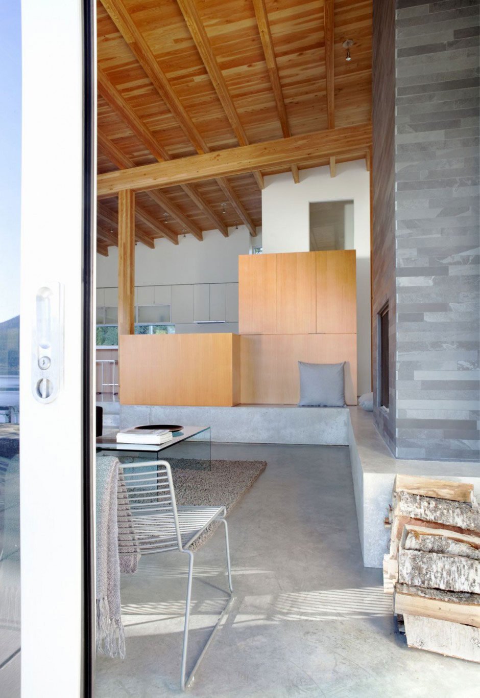 Sliding Door Next to the Dining Room Shuswap Cabin by Splyce Design