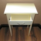 Small White Table With a Rack