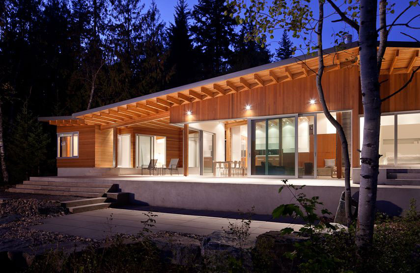 The Front Side of Shuswap Lake Cabin by Splyce Design Night Situation