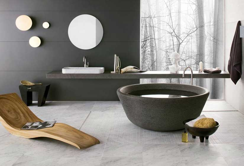 Artistic Bathrooms from Neutra with Stone Tub and Lounge Wooden Chair