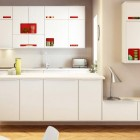 Beautiful White Kichen with Red Hardware Storage