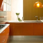 Di Lorio Cucine Orange Kitchen with Chandelier