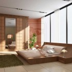 Drop Dead Modern Bedroom with Wood Accent and Grass Rug by Bent Masrya