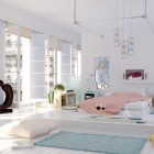 Drop Dead White Bedroom with Aqua Rug by Elif
