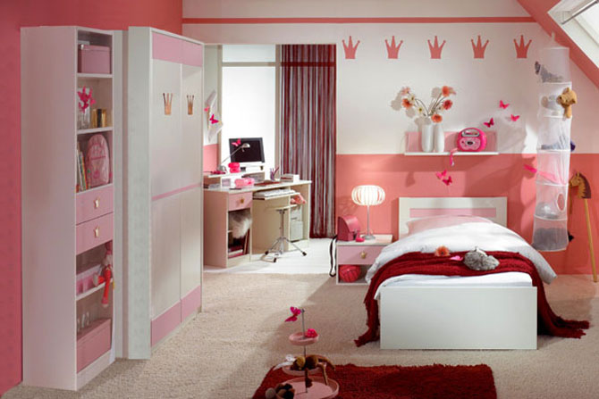 Girls Pink Badroom With Knick Knacks And Red Rug
