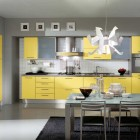 Modern Yellow Kitchen Design with Unique Chandelier and Black Rug
