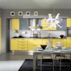 Modern Yellow Kitchen Design with Unique Chandelier and Black Rug