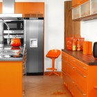Modular Orange Kitchen with Big Refrigerator