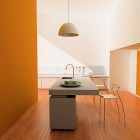 Simple And Minimalistic Orange Kitchen With Chandelier