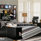 Simple Teen Boys Room Design with Picture Frames in Wall