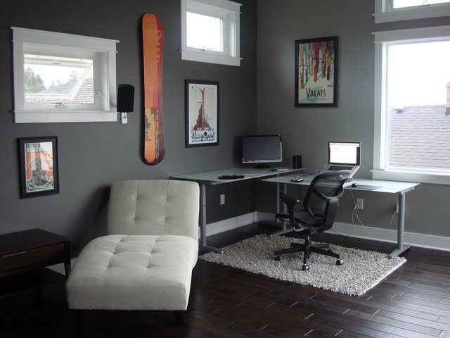 Awesome Corner Desk with Skis on the Wall and White Couch