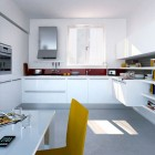 Beautiful Minimalistic White Ktichen Design with Red and Yellow Accents