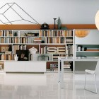Beautiful White Home Library with Circular Lamp