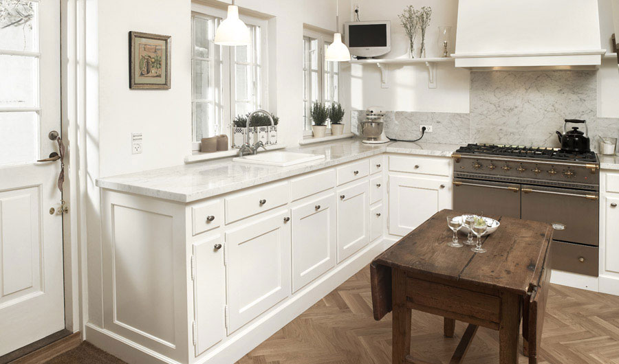 Beautiful White Kitchen with LCD TV
