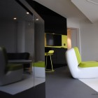 Black and White Loft Studio Area with Gree Accents