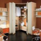 Dominant Orange Color Kids Room with Wadrome at Corner