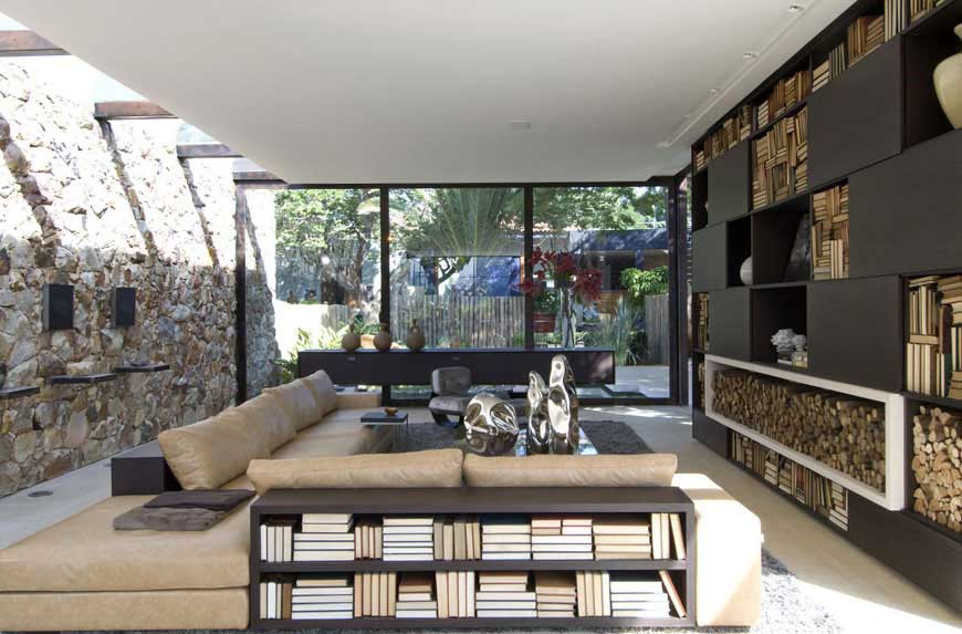 Elegant Living Area with View of Yard and Stone Wall