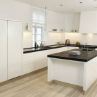 High Gloss White Kitchen with Table in the Middle