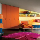 Sloping Ceiling Kids Room with Orange Wadrobe