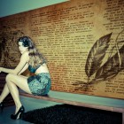 Typewriting Wallpaper by Gio Pagani with Sexy Model And Black Rug