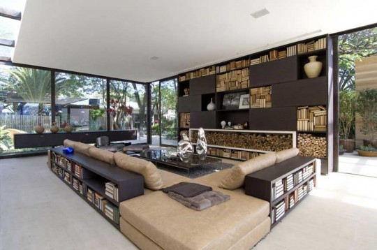 White Living Room with Bookshelves and Glass Wall