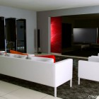 White Sofas Lounge with Red Wall Decoration