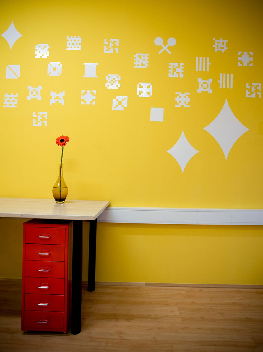 Yellow Wall With Dot Pixel Decorations Interior Design Ideas