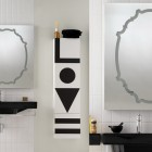 Black Sinks in White Wall Decor with Unique Mirror Design