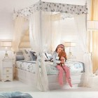 Cute Girl Bedroom with White Canopy Bed