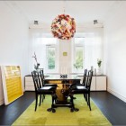 Floral Chandelier Dining Room with Green Rugs