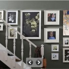 Hanging Photos in Grey Wall at the Side of Staircase