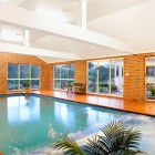 Indoor Pool Preview with Brick Wall Decor