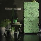 Leaf Priting Cocoon Shelving System in Dark Room