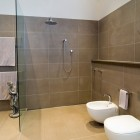 Modern Brown Bathroom with Glass Wall Separate