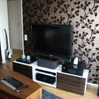 Modern LCD TV Room Design with Leaf Wallpaper