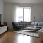 Natural Lighting Living Room with LCD TV and Sofa Set