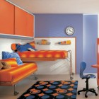 Sky Blue and Orange Kids Room with Circular Rugs Motive with Fexible Computer Desk