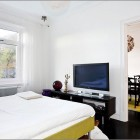 Techy White Bedroom with LCD TV