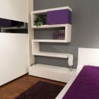 Unique White Bookshelves with Puple Accents