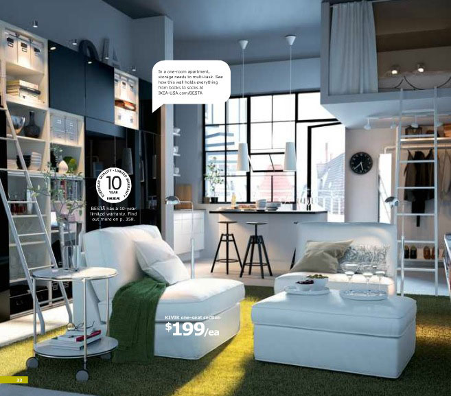 White Ikea Living Area with Shelves and Green Rugs