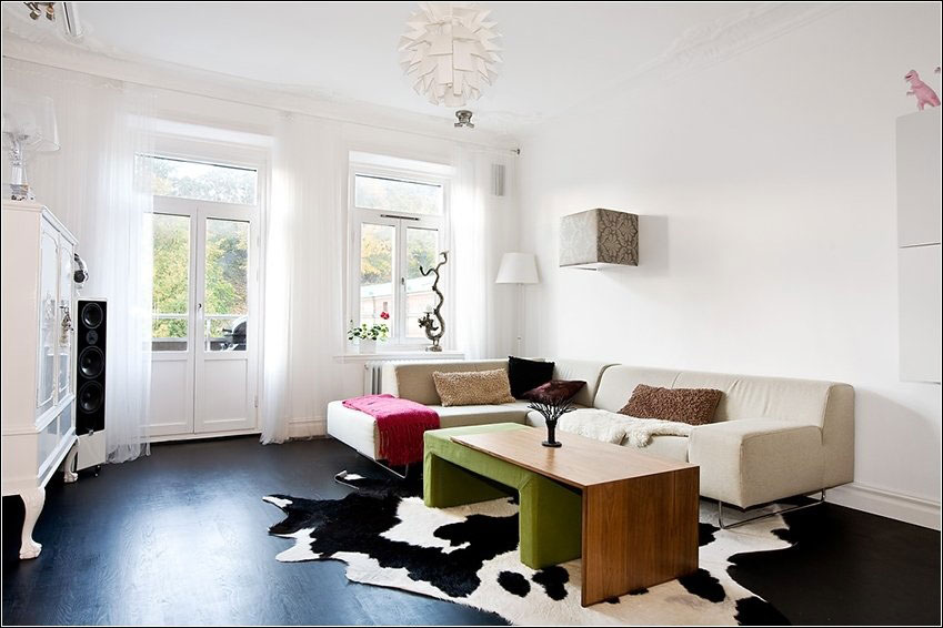 White Living Room Swedish Home with Cow Print Rugs
