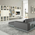 White Shelves with Grey Sofa and Yellow Accents
