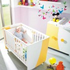 White and Yellow Nursery Crib