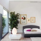 Beautiful Gray White Bedroom with Glass Wall and Pink Pillow