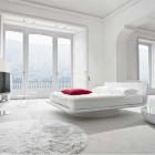 Bright and Luxury White Bedroom with Red Pillow