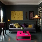 Dark and Moody Livinng Room Design with Pink Coffee Table