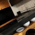 Futuristic Black Kitchen with Wooden Furniture