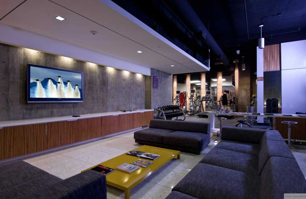 Modern living room tv area beside gym area interior Living room gym